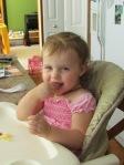 Toddler having lunch in highchair