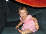 Toddler playing in sofa